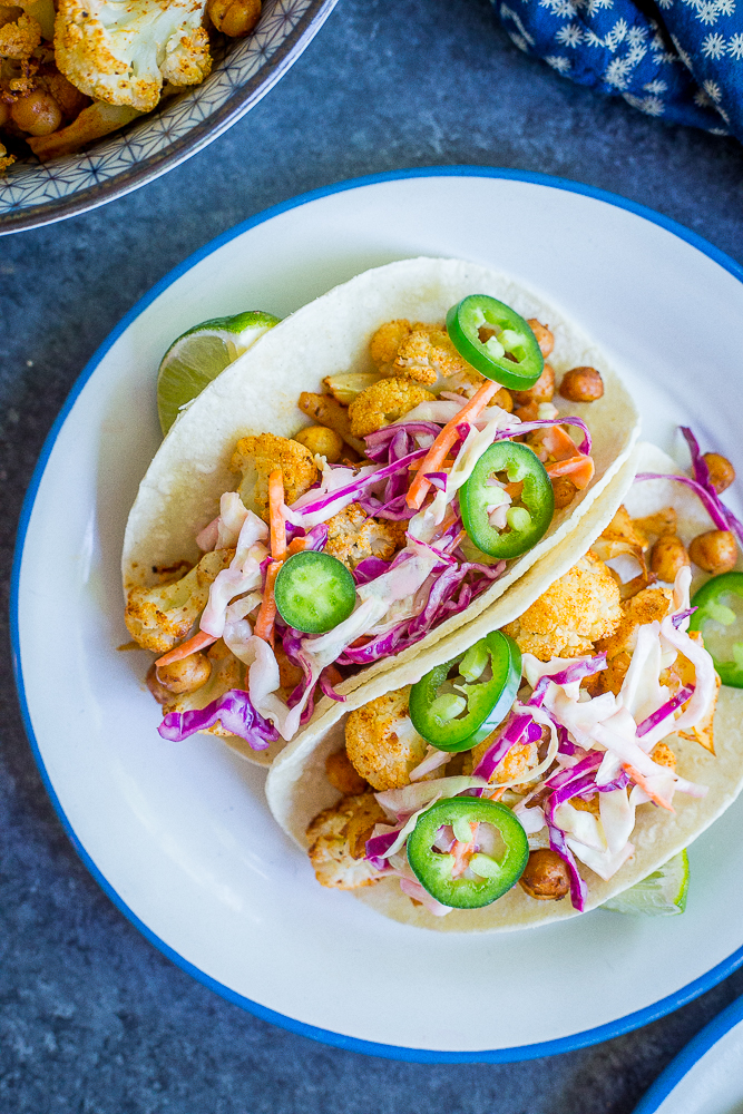 These BBQ Cauliflower and Chickpea Tacos with Creamy Lime Slaw are a delicious, filling and flavorful vegan dinner that everyone will love! They're so easy to make too! Gluten free/ vegan/ vegetarian/ dinner