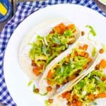 Roasted Butternut Squash Tacos with Maple Brussels Sprout Slaw & Sage Crema