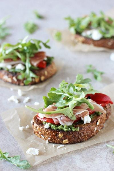 Arugula_prosciutto_goat_cheese_open_faced_sandwich