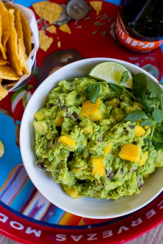 Mango Black Bean Guacamole-This delicious guacamole comes together in ten minutes and goes perfectly with so many things!