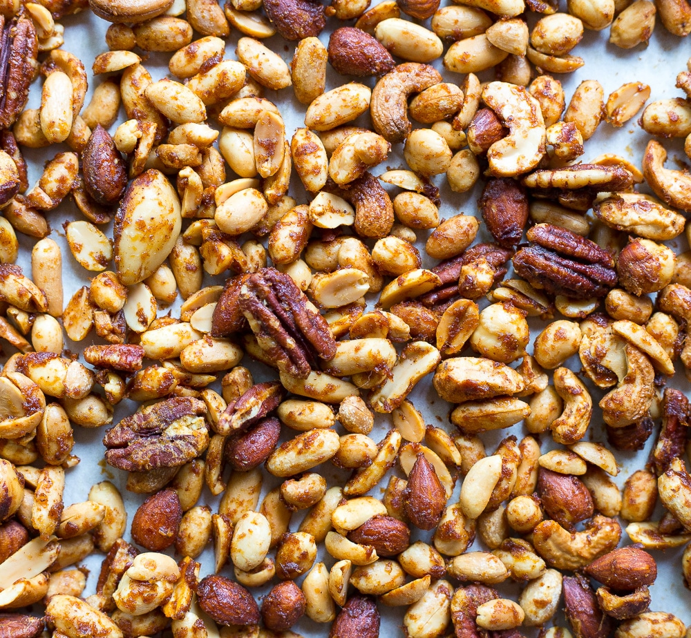 These Pumpkin Spiced Mixed Nuts are as easy to make as they are addicting!  You will want to make more than one batch!  They make for a perfect holiday snack!