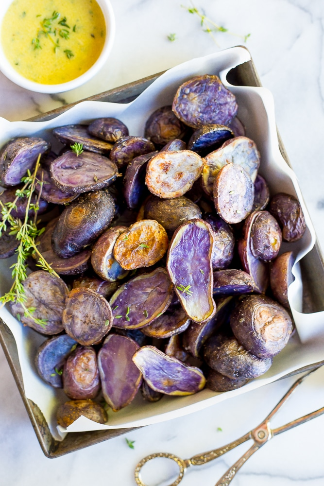 Add some color to your holiday table by making these Roasted Purple Potatoes with Lemon Dijon & Thyme Dressing!  A deliciously flavorful side dish!