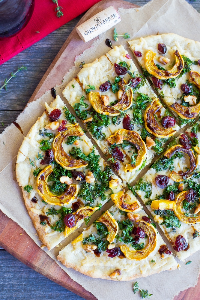 This Delicata Squash, Kale and Parmesan Flatbread will be the perfect appetizer at all of your holiday parties!