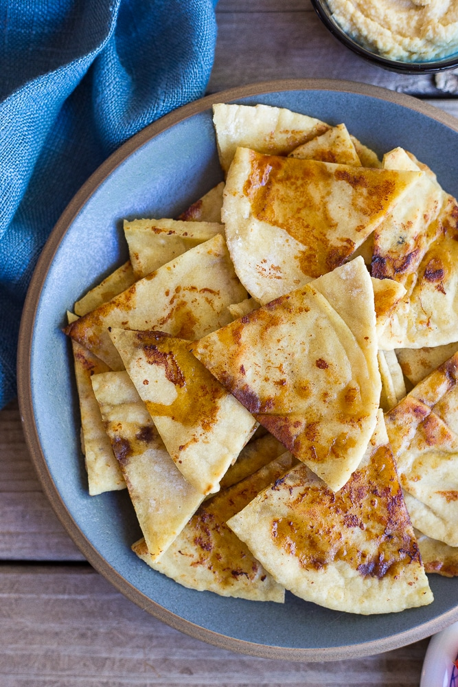 This Pan Fried Pita Bread comes together in minutes and will make you never want to eat plain pita bread again!  It goes great with hummus and vegetables!