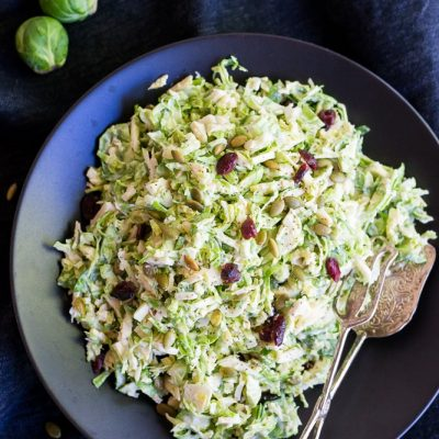 Brussels Sprout Slaw with Dried Cranberries & Pepitas