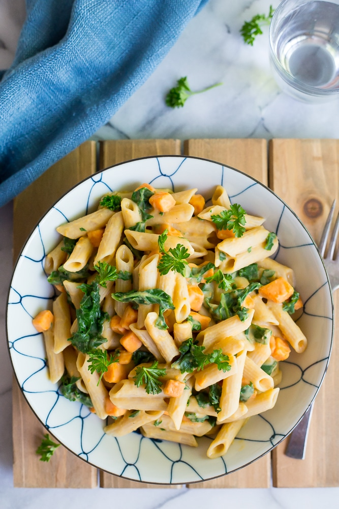 This delicious Creamy White Bean Pasta with Sweet Potato and Kale is so easy to make and comes together in only 30 minutes!  It's the perfect vegetarian dish for a weeknight dinner!  Gluten free and vegan too!