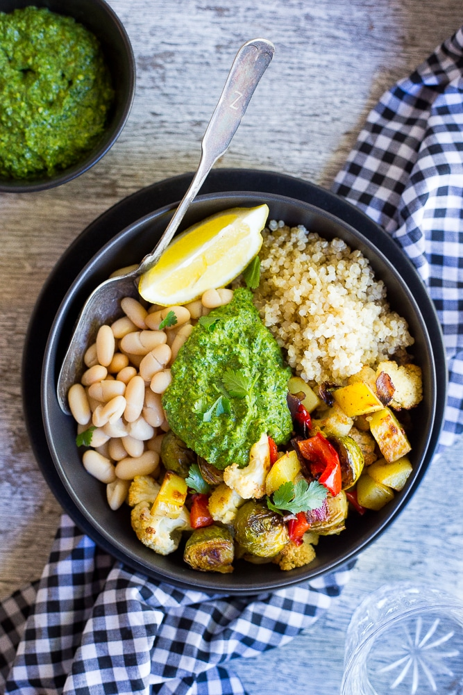 These Roasted Veggie Buddha Bowls are so healthy and delicious!  Just put everything in one bowl for a perfect comfort food dinner!  All topped off with some refreshing pesto.  Gluten free and vegan!