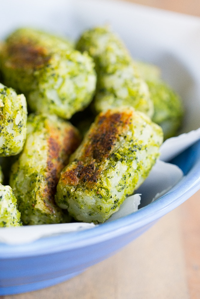 These 4 Ingredient Broccoli Tater Tots are packed with tons of broccoli and baked in the oven making them a really healthy side dish or snack!  A perfect way to get some extra veggies into your life!  Vegan and gluten free!