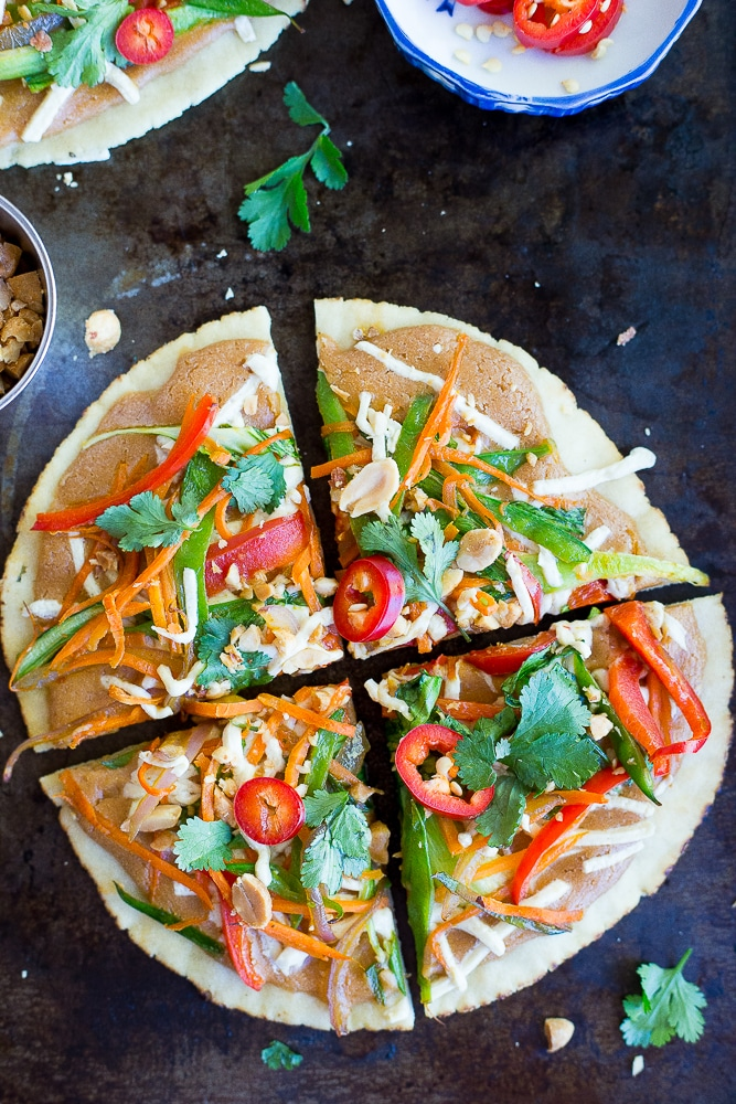 These Easy Thai Vegetable Pita Pizzas only take 30 minutes to make and are great for a delicious vegetarian weeknight dinner!  Gluten free and vegan option too!