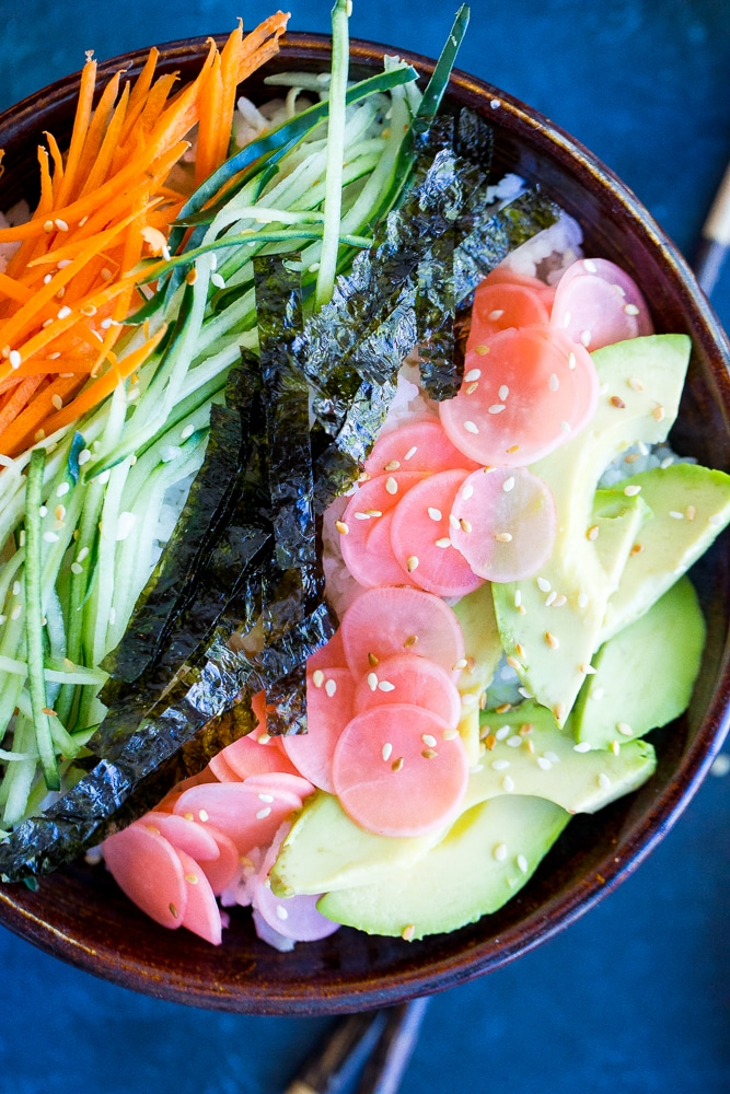These Veggie Sushi Bowls with Quick Pickled Radishes come together really quickly for a delicious and healthy meal!  Eat them for dinner or make them as a lunch meal prep idea!  Vegan and gluten free!