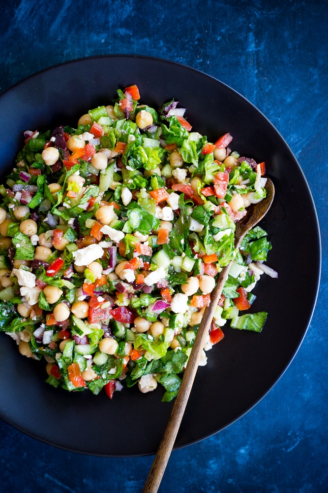 Mediterranean Chopped Salad Pitas- These delicious pitas are quick and easy to make and full of fresh vegetables. Perfect for a healthy lunch or no cook summer dinner!
