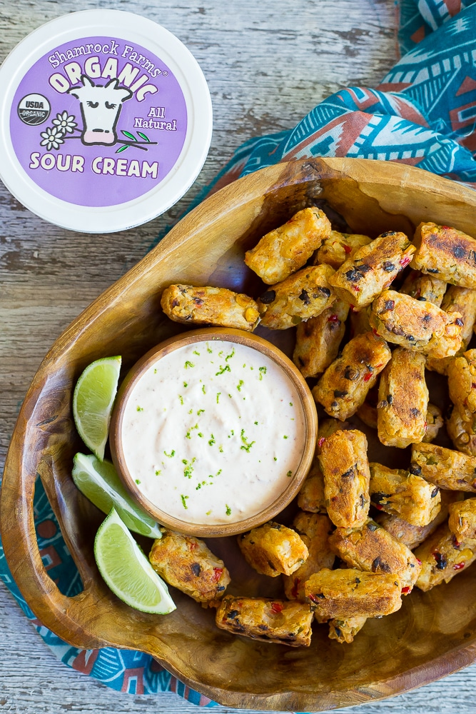 Tex Mex Tater Tots with Creamy Chipotle Lime Dip-  Baked to perfection for a healthy and flavorful side dish!  Dipped into a creamy and tangy dip!  You'll never buy frozen tater tots again after you make your own!  Gluten free, vegetarian