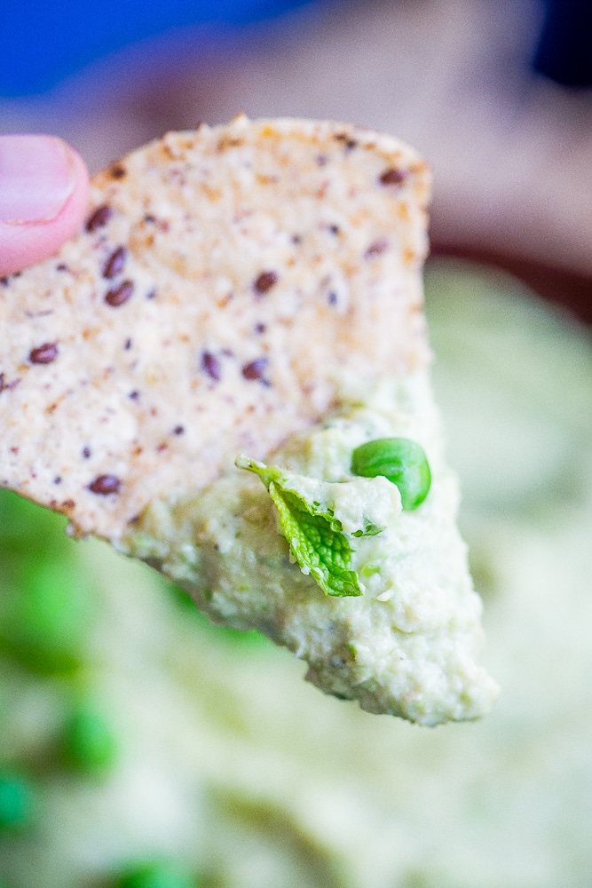 Minty Sweet Pea Hummus - A fresh and flavorful twist on the classic!  Great for a healthy appetizer, snack or to put on sandwiches and salads!  Gluten free, vegan, healthy