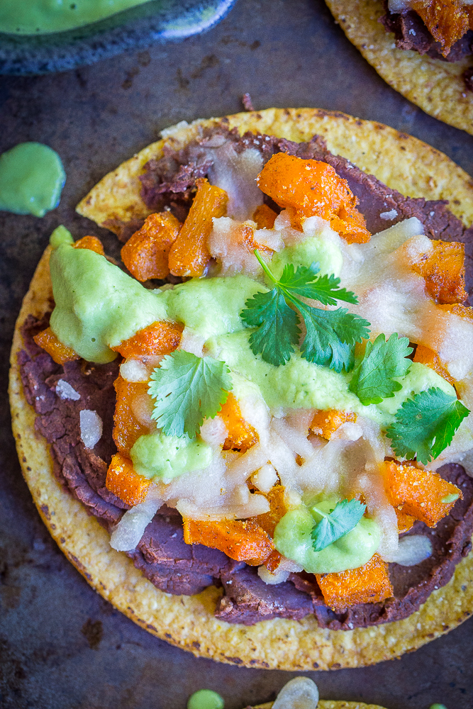 These Roasted Butternut Squash Tostadas with Avocado Lime Sauce are a really delicious easy dinner! They're healthy, vegan and gluten free! A perfect Mexican inspired fall dinner!