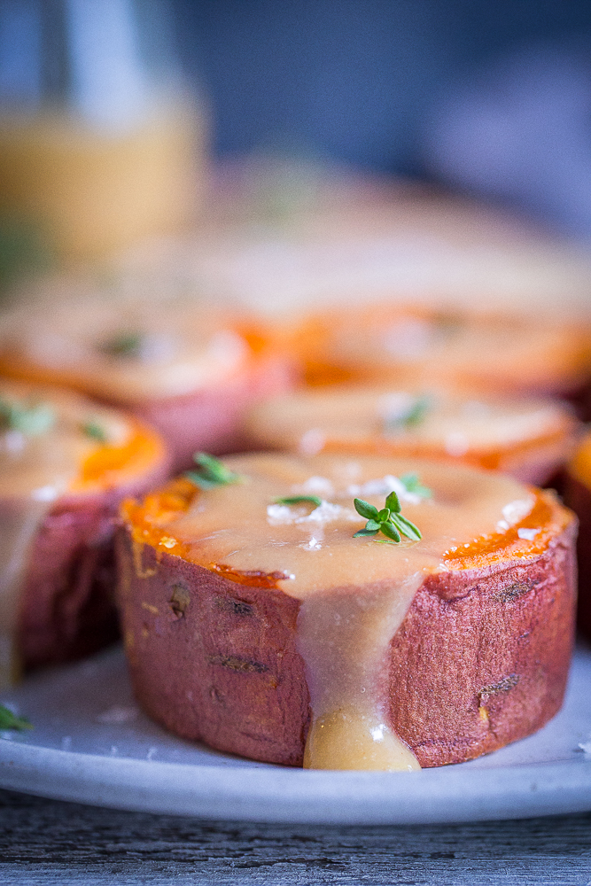 Roasted Sweet Potatoes with Tahini Maple Butter - These delicious and decedent sweet potatoes are so easy to make and are delicious as a side dish or snack! They're also vegan and gluten free!
