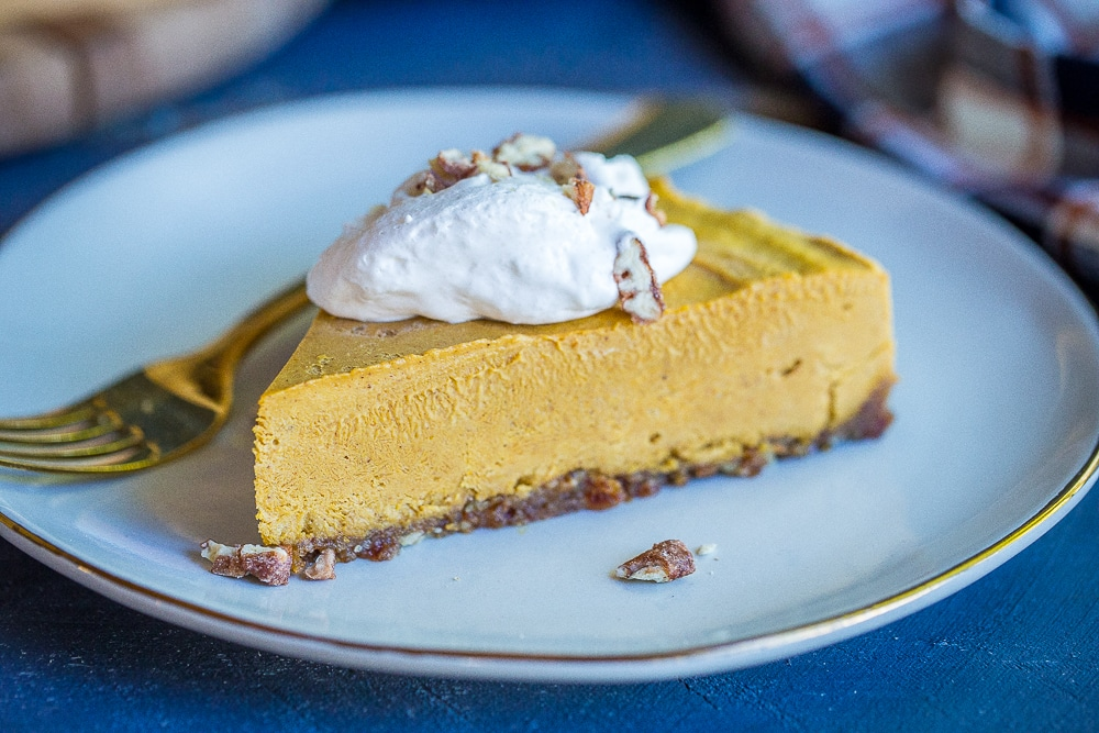 This No Bake Vegan Pumpkin Cheesecake is so creamy and flavorful! You won't even be able to tell it's vegan! It will be perfect for your holiday meal! Gluten Free, Vegan