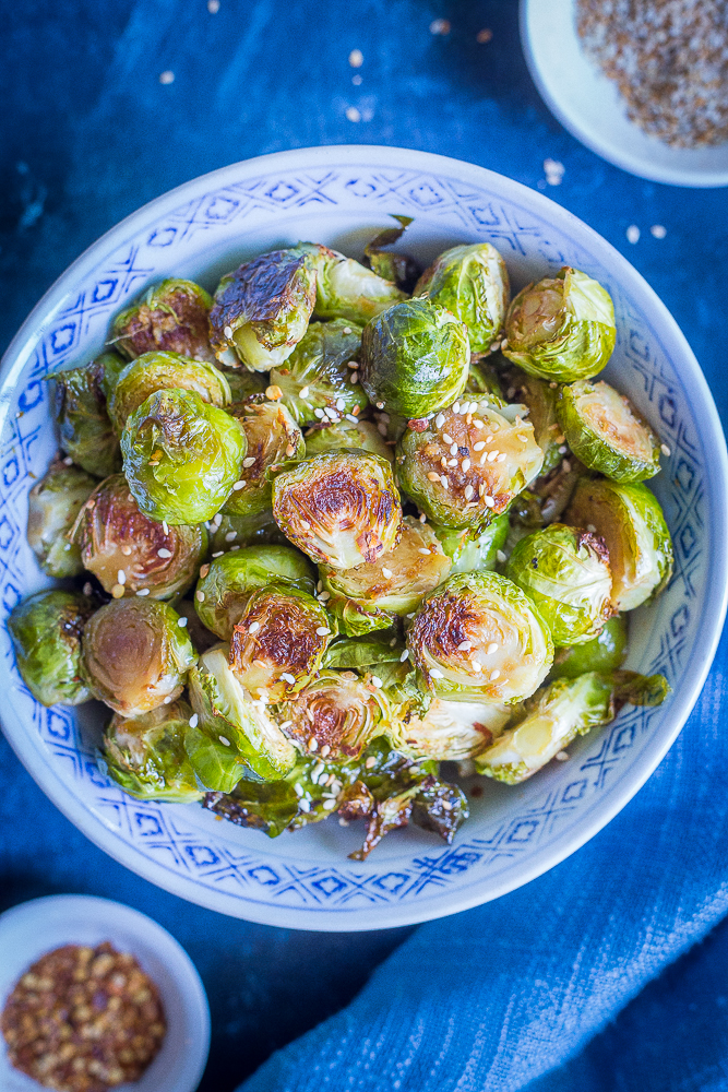 These Maple Sesame Ginger Roasted Brussels Sprouts are full of flavor and will be the perfect side dish for your holiday table! They'll turn everyone into Brussels sprout lovers! Gluten free and vegan