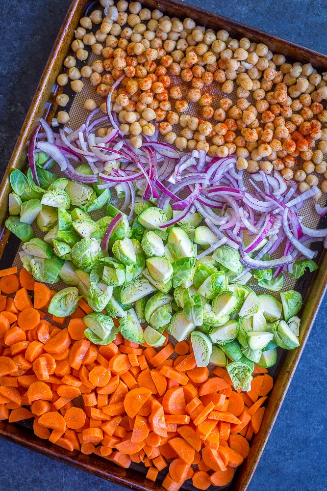 These Roasted Vegetable and Chickpea Meal Prep Bowls are perfect for an easy, healthy and delicious meal prep lunch! They're also gluten free and vegan. Make them on Sunday and you'll have lunch for the next four days!