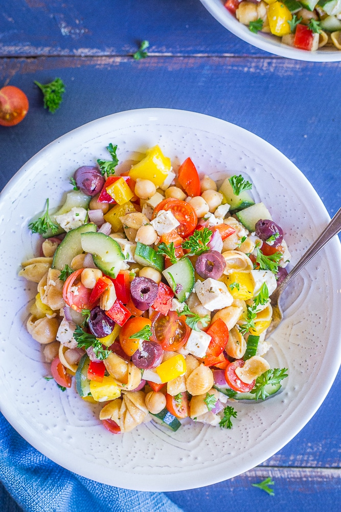 This Loaded Greek Pasta Salad is filled with lots of vegetables and protein! It's a delicious and healthy meal that can be eaten as a lunch or dinner. It's also vegan and gluten free!