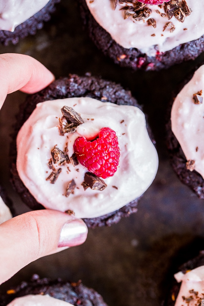 These Healthier Chocolate Cupcakes with Raspberries are made with healthy ingredients and packed with raspberries and beets to make the extra nutritious! They're also vegan, gluten free and refined sugar free! Perfect for dessert and great to bring to parties!