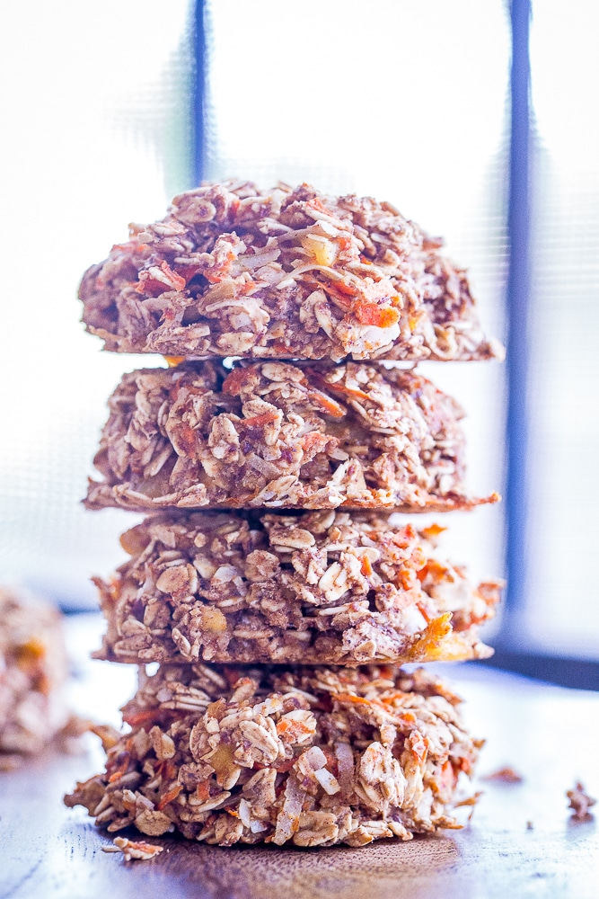 These Healthy Carrot Cake Breakfast Cookies are perfect for an easy make ahead breakfast or snack! They're packed with lots of carrots, coconut and pineapple and filled with lots of warm spices! They're gluten free, vegan and refined sugar free too!