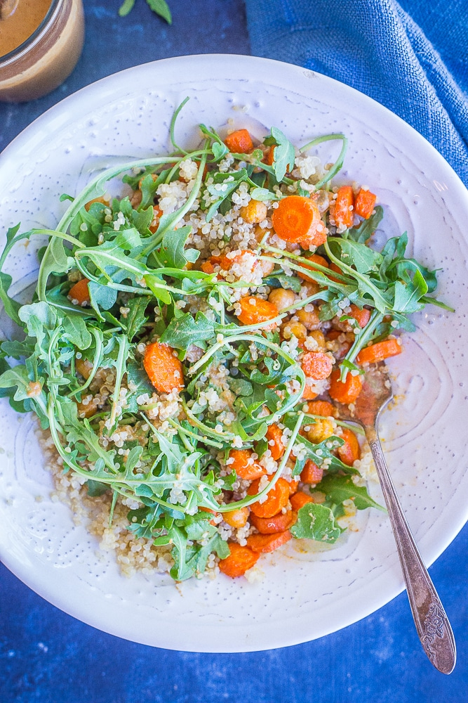 This Roasted Carrot and Chickpea Salad with Orange Ginger Cashew Dressing is such a light and flavorful meal prep lunch recipe! It's loaded with protein and veggies making it filling and healthy! Make it for meal prep or for dinner! Gluten free and vegan!
