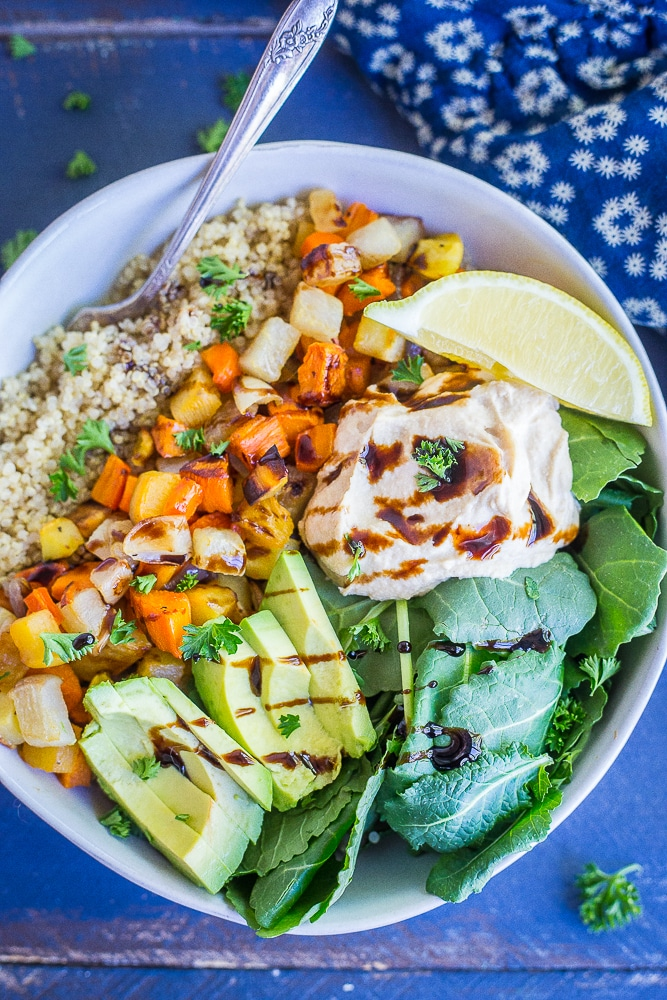 These Roasted Root Vegetable Buddha Bowls are packed with veggies and protein making them a healthy and filling lunch or dinner! Easy to make and great for meal prep! They're also gluten free and vegan!
