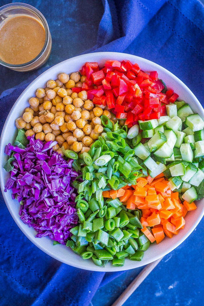 Asian Chickpea Chopped Salad with a napkin and a jar of dressing