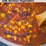 Instant Pot Vegetarian Chili in the instant pot with a wooden spoon