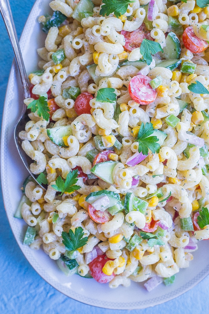 Close up view of Healthier Mayo Free Macaroni Salad on a serving platter with two spoons