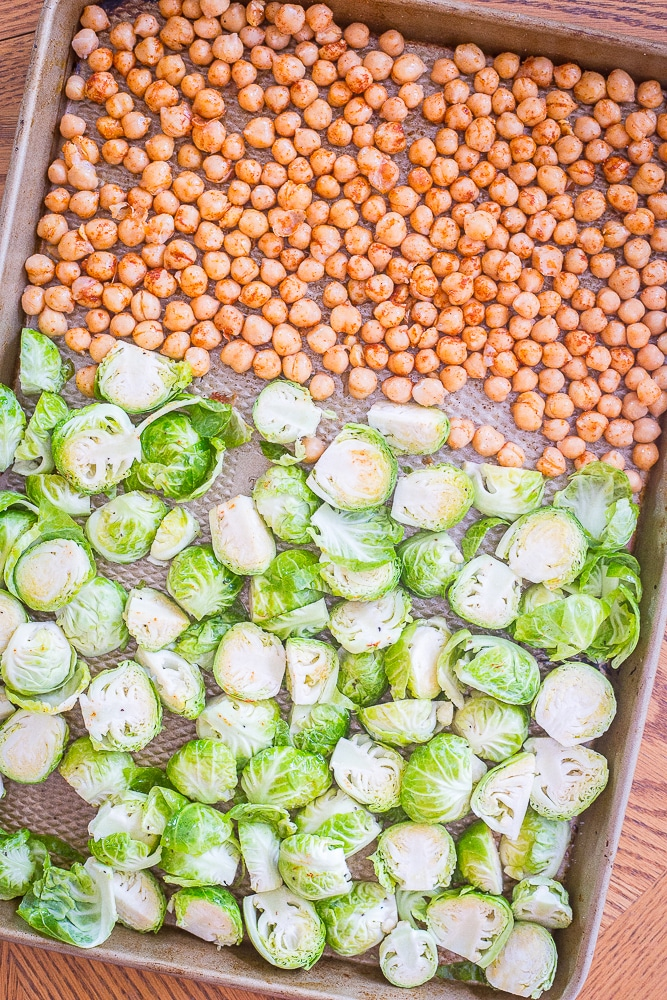 Brussels sprouts and chickpeas on a sheet pan for my Roasted Brussels sprout and Chickpea Meal Prep Bowls