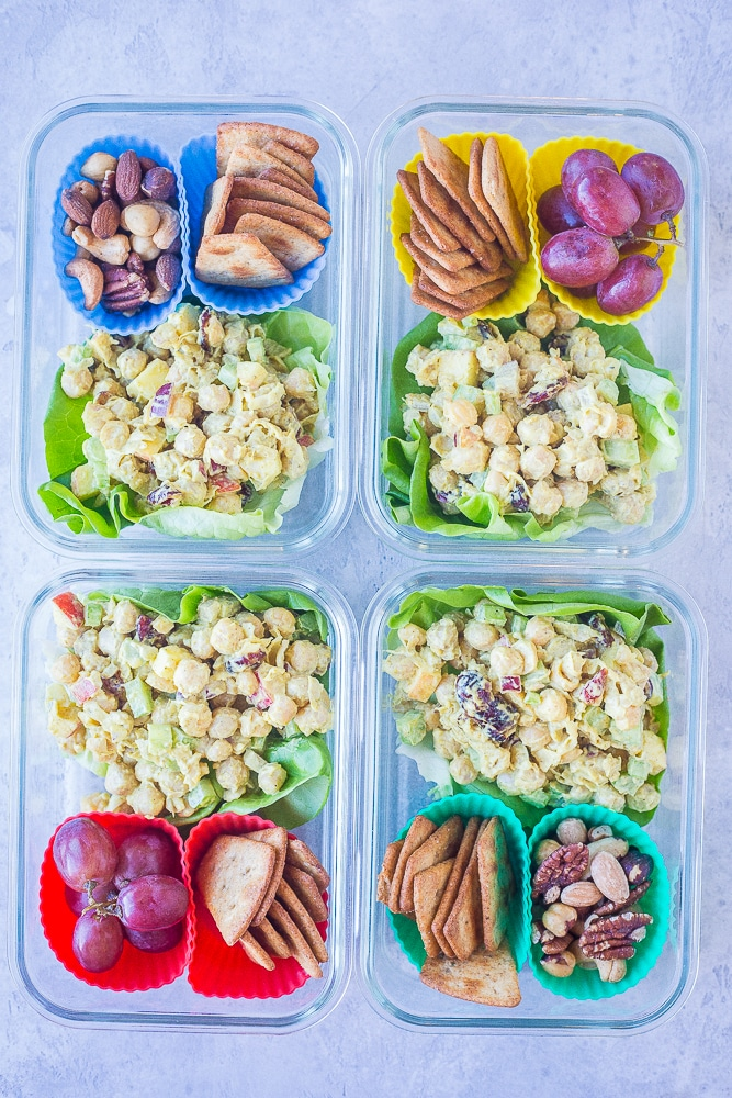 Four Curried Chickpea Salad Meal Prep Bowls next to each other.