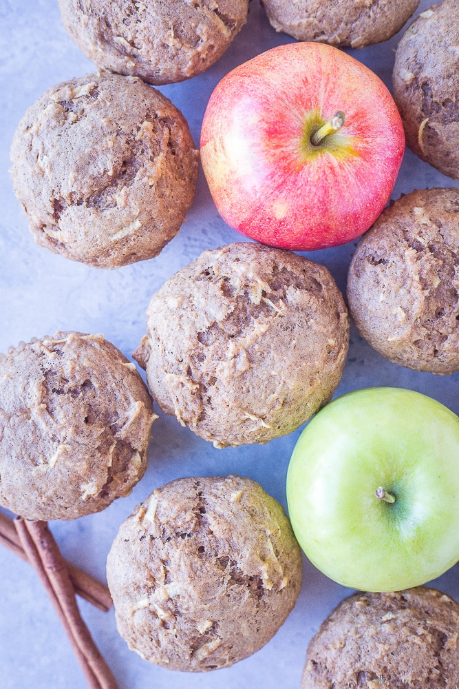 Best Healthy Apple Cinnamon Muffins on a table with apples and cinnamon sticks
