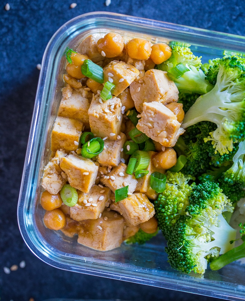 Closeup of Orange Tofu Chickpea Bowls in a meal prep container