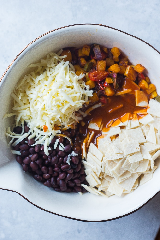 A bowl of ingredients for Black Bean Enchilada Casserole with Butternut Squash