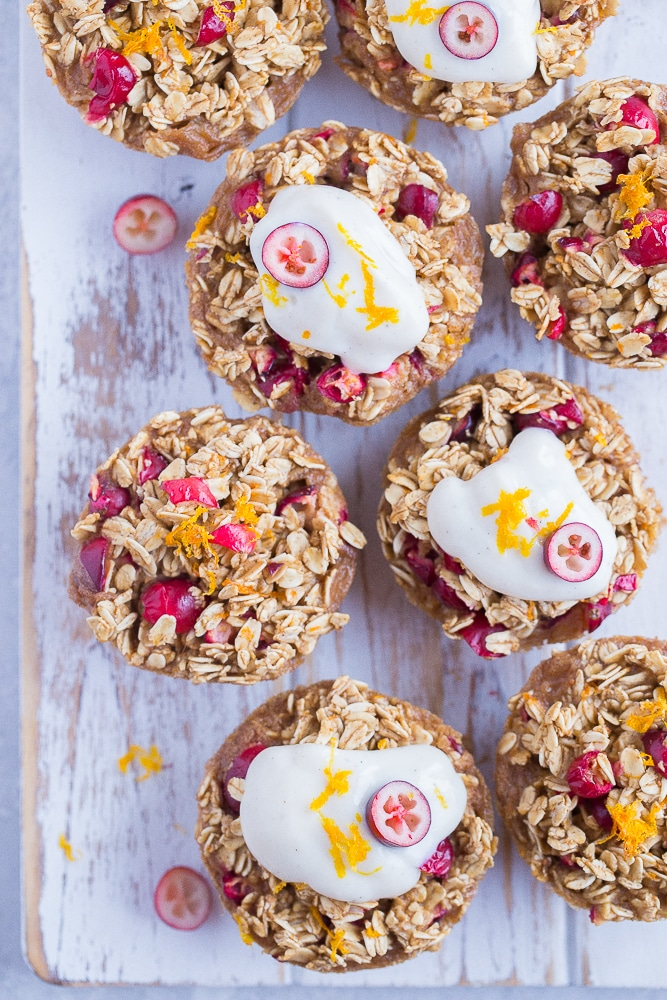 Orange Cranberry Baked Oatmeal Cups on a white background