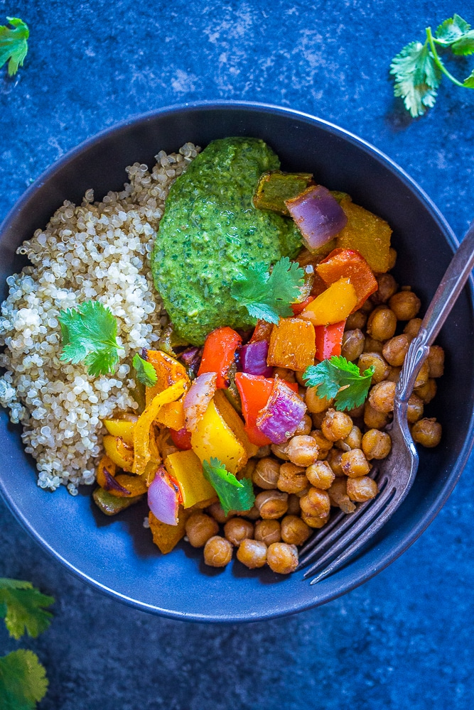Chickpea Fajita Meal Prep Bowls in a black bowl with a fork