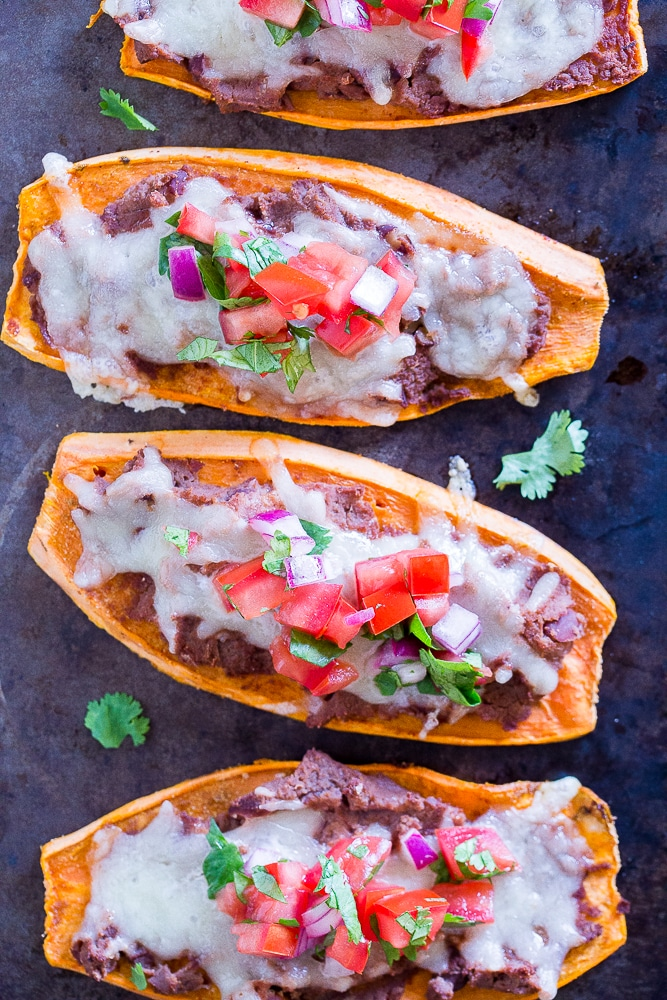 Sweet Potato Tostadas on a baking sheet with toppings