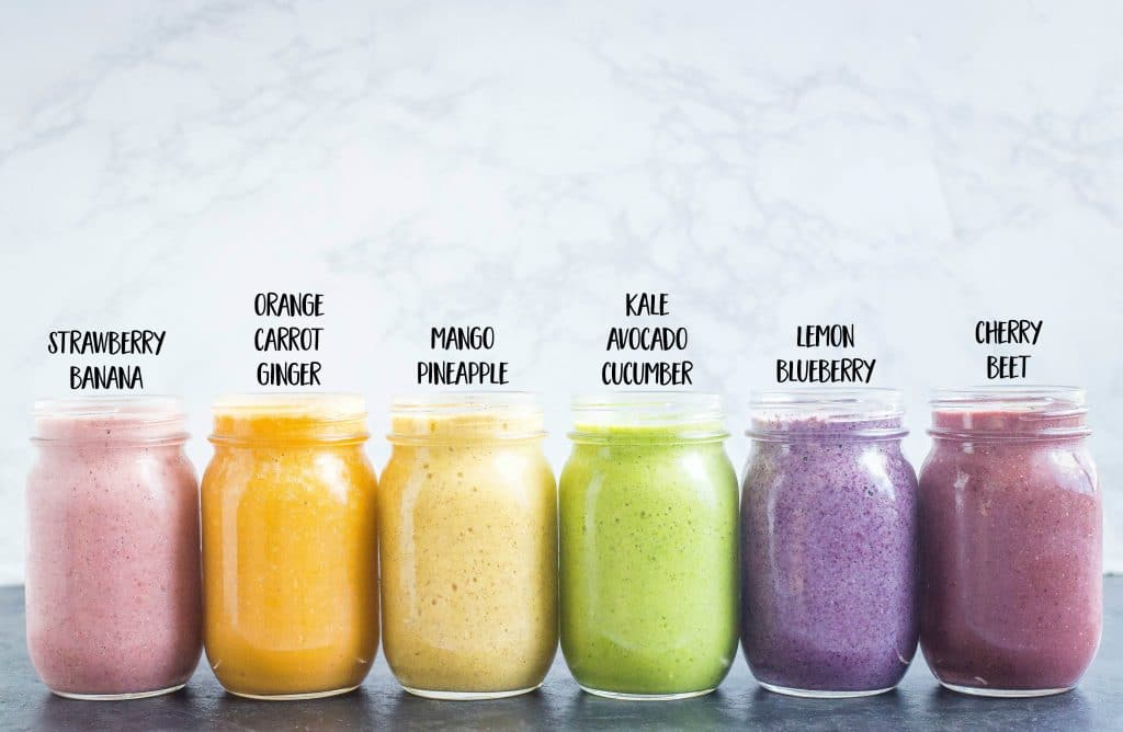 six healthy smoothie recipes in glass jars