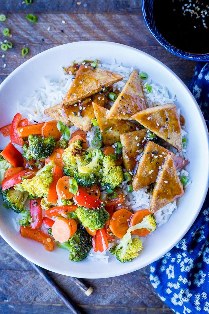 Big bowl of teriyaki tofu with vegetable and rice