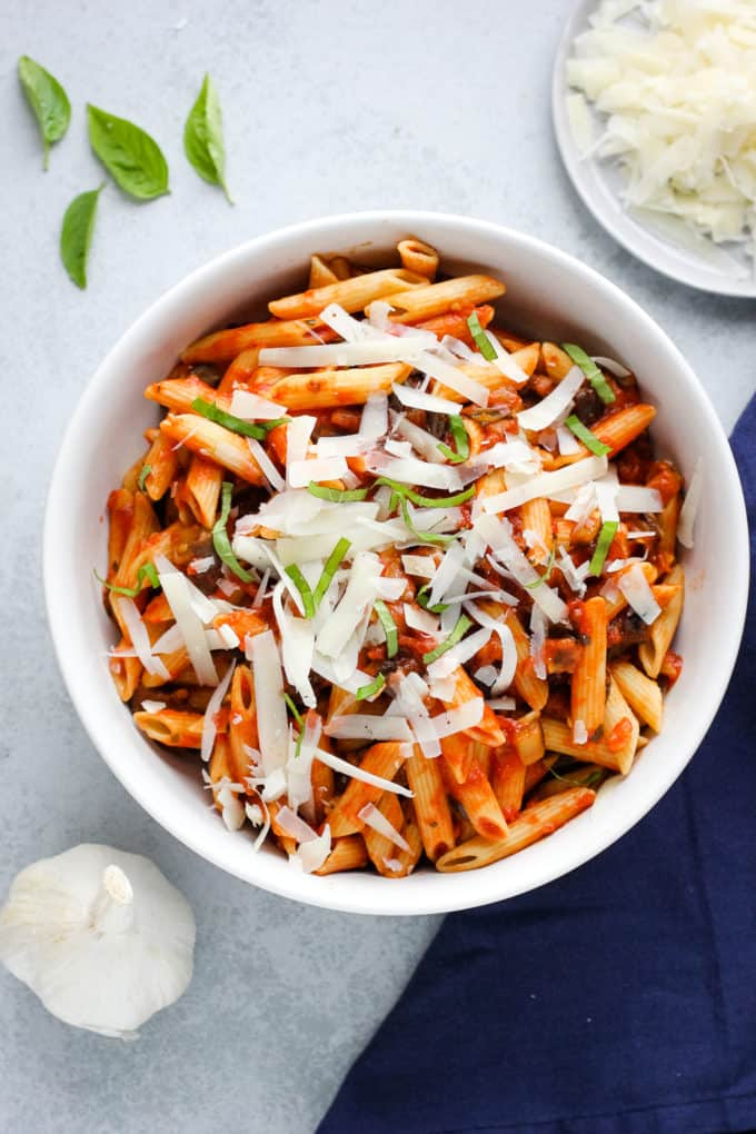 Pasta alla norma with grated cheese and fresh basil