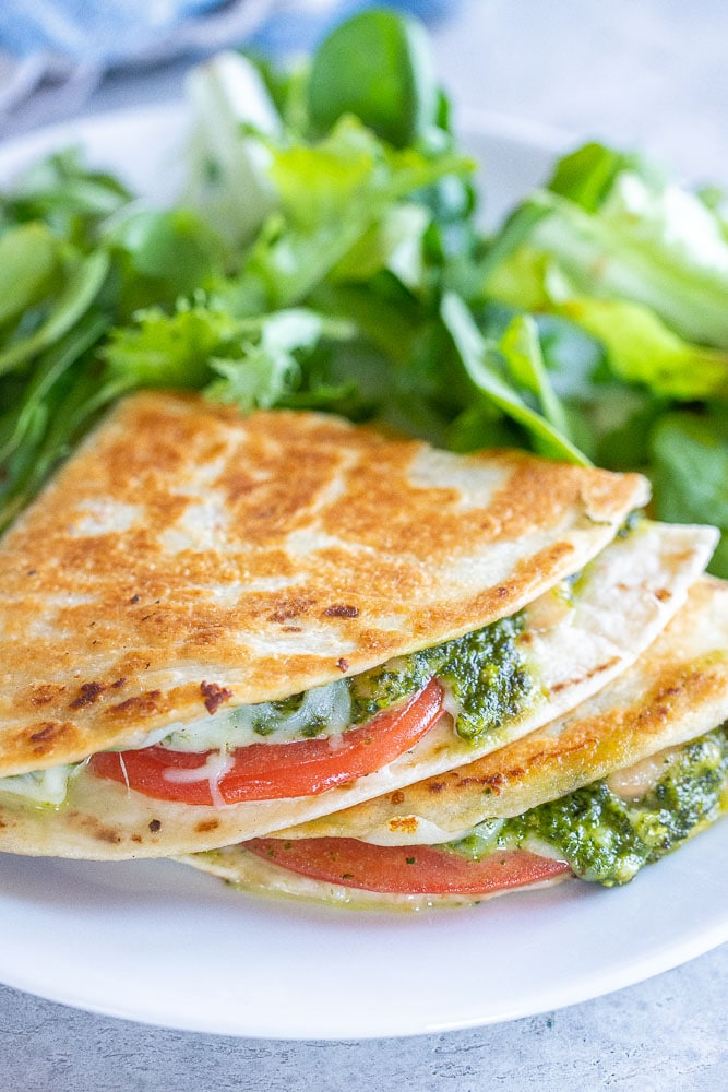 quesadillas stacked with pesto and tomato