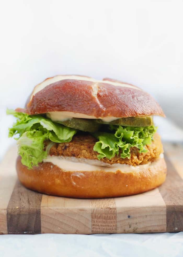 pumpkin walnut burger with lettuce and pickles