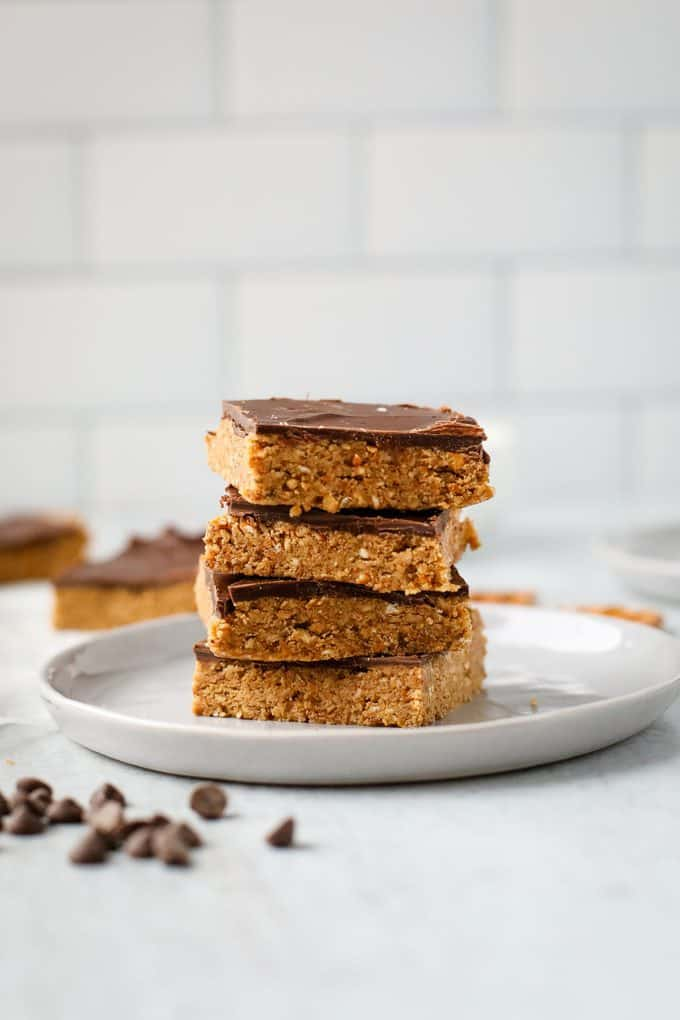 stack of peanut butter pretzel bars on a white plate
